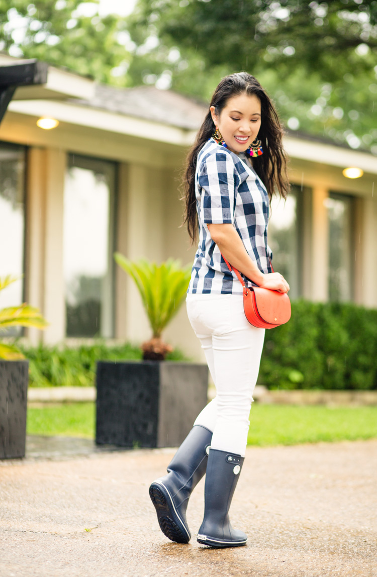 gingham top, crocs jaunt rain boots, tory burch red mini saddlebag, tassel earrings | spring rainy day outfit