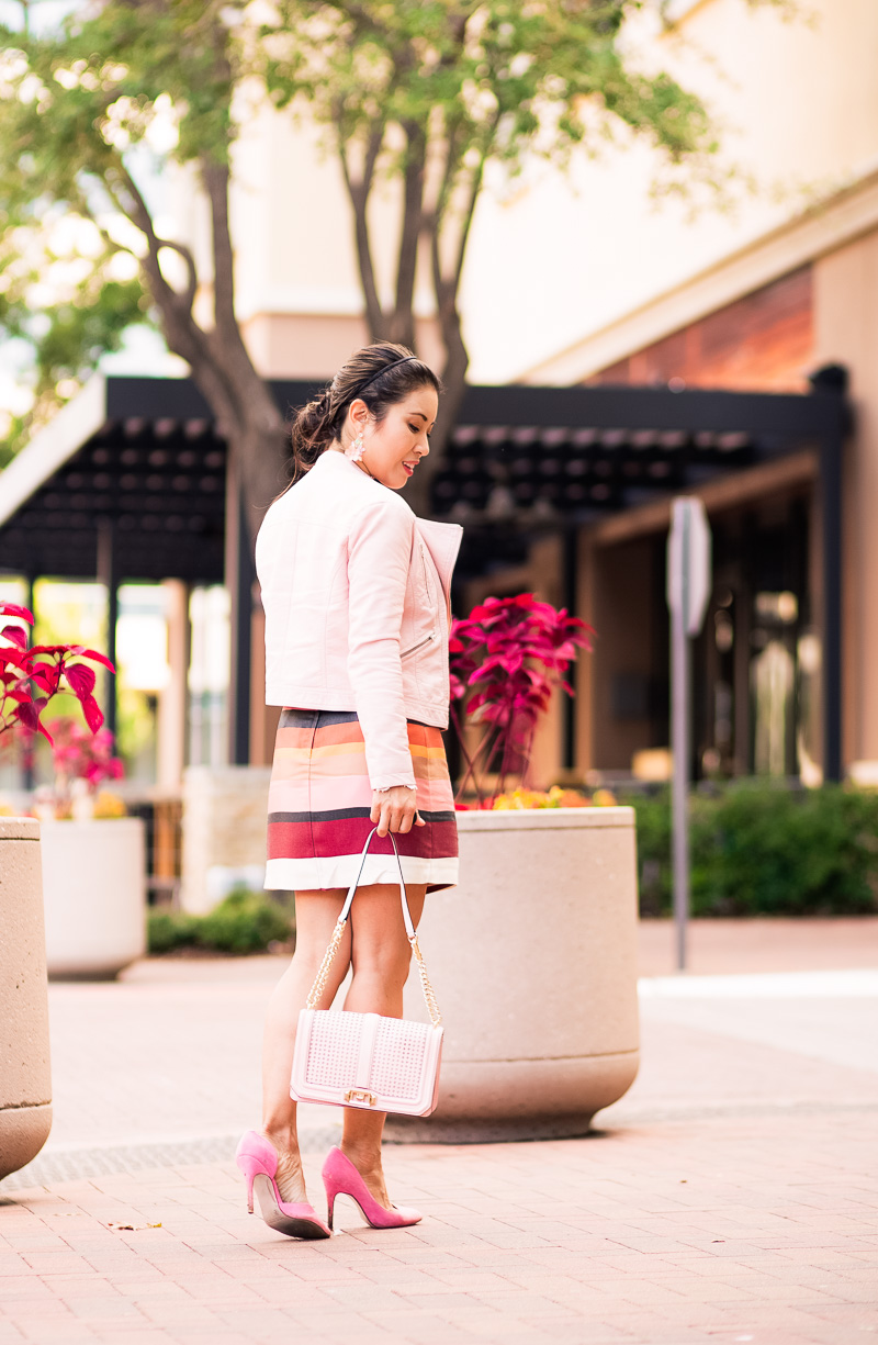 cute & little | petite fashion blog | pink moto jacket, striped mini skirt, pink suede pumps, minkoff love crossbody | spring fall outfit
