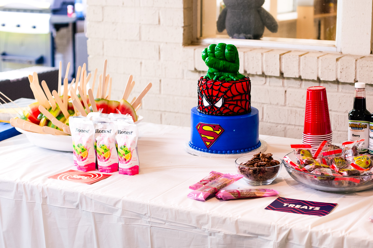 toddler superhero birthday party table setup food decorations