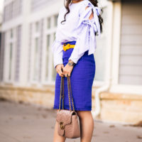 Cute Shirt With Bows And Skirt With Fringe