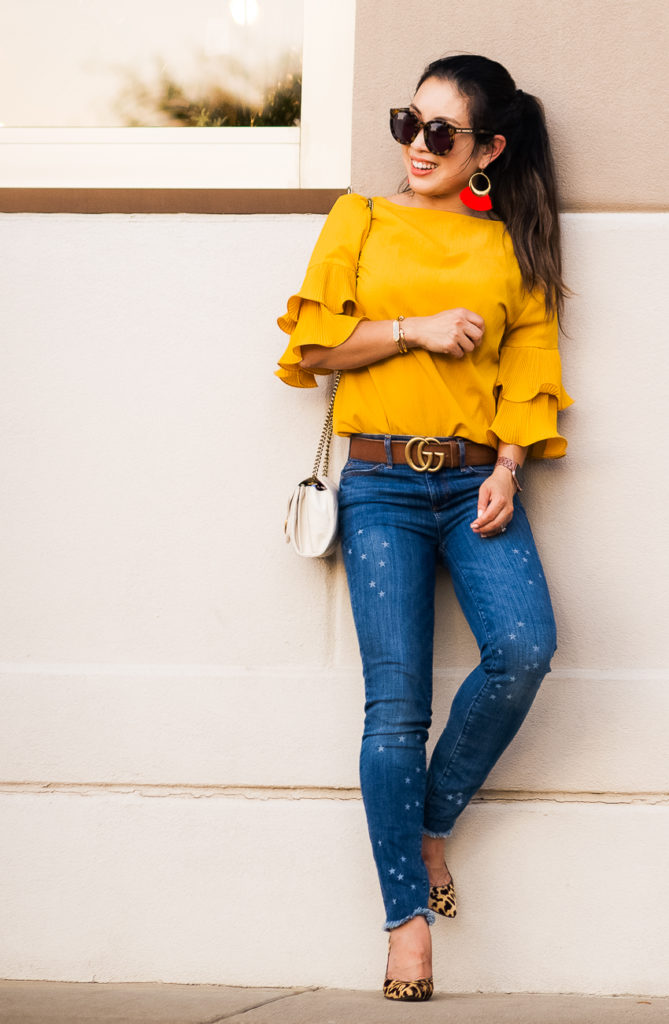 loft star frayed skinny crop jeans, leopard pumps, kinsley armelle cherry red fringe earrings | LOFT | Abercrombie | J. Crew Factory | Starstruck: Outfits For The Star Print Obsessed featured by popular Dallas petite fashion blogger Cute & Little