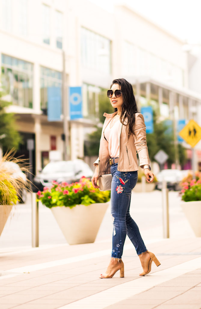 loft v-neck sweater tank pink fizz, express high waisted floral embroidery jeans, gucci double g belt dusty pink, express minus the leather double peplum moto jjacket, gucci gg0106s havana sunglasses   spring fall outfit   Elevating Your Basic Outfit With High Waist Embroidered Jeans featured by popular Dallas petite fashion blogger Cute & Little