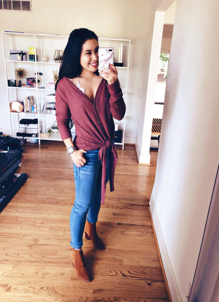 Amazon Winter Fashion featured by top US petite fashion blog Cute & Little; Image of a woman wearing Amazon Waffle Front Tie Henley shirt, Free People 'Adella' bralette, American Eagle Button-Fly Jeans and Marc Fisher 'Alva' shoes.