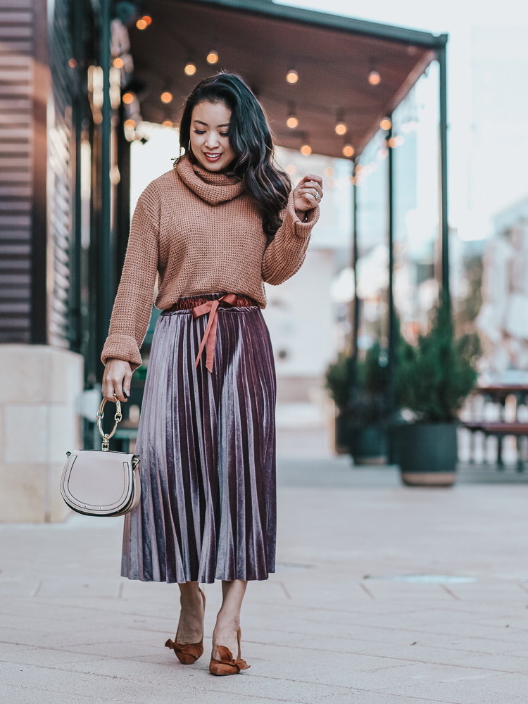 Spring Favorites featured by top US petite fashion blog Cute & Little; Image of a woman wearing Amazon Waffle Sweater, SheIn Knot Front Pleated Velvet skirt, Sole Society shoes, Amazon Bracelet Crossbody bag, Baublebar 'Faidra' Resin Drops earrins in tortoise.