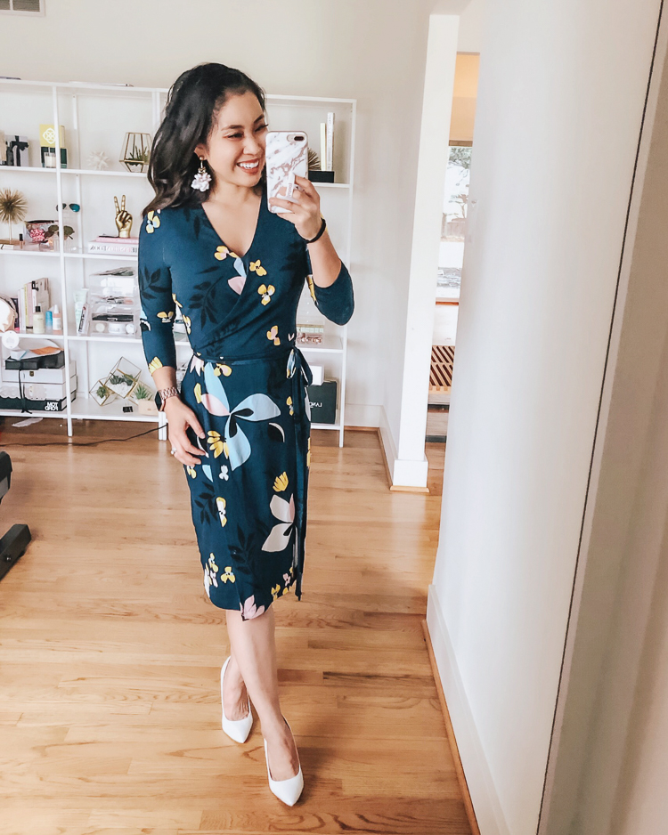 Spring Dresses featured by top US petite fashion blog Cute & Little; Image of a woman wearing target A New Day floral navy wrap dress.