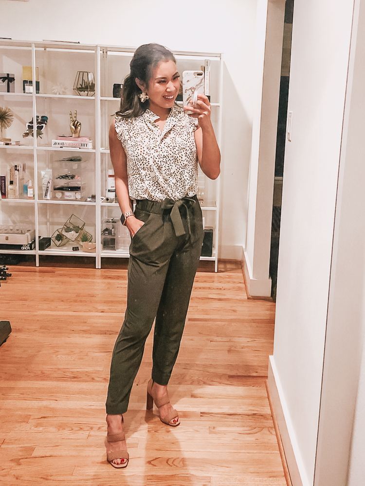 LOFT Sale featured by top US petite fashion blog Cute & Little; Image of a woman wearing loft garden ruffle henley shell, express high waisted paperbag olive pants