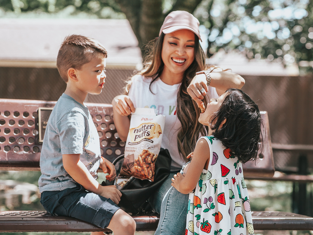 Healthy Snacks On-The-Go featured by top US lifestyle blog Cute & Little; Image of a woman playing with her kids at the park.
