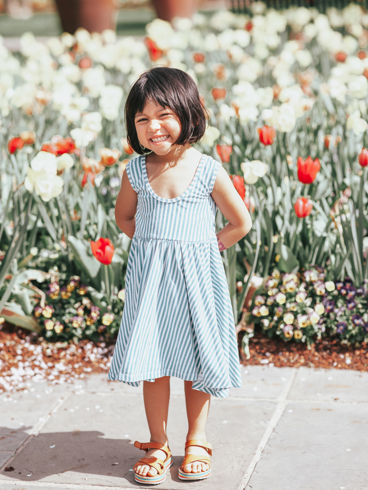 cute & little | dallas popular mom fashion blog | easter family outfit ideas | spring matching family photoshoot outfit ideas | Easy Easter Outfit Ideas For The Family featured by top US fashion blog, Cute & Little; image of a a girl wearing an  Alice + Ames dress
