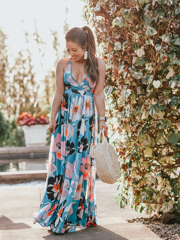 Blue Floral Maxi Dress featured by top US fashion blog Cute & Little; Image of a woman wearing Express Strappy Lace-Up Cut-Out Maxi Dress worn with these Bristols nipple covers, See By Chloe 'Glyn' Espadrilles, Amazon Straw Tote Bag and Baublebar 'Contessa' Tassels earrings.