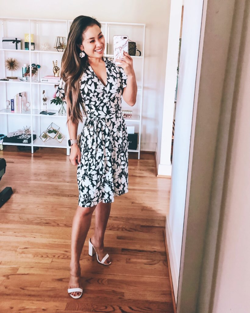 Best Memorial Day Weekend Sales featured by top US fashion blog cute & little; Image of a woman wearing an ann taylor black white floral wrap dress.