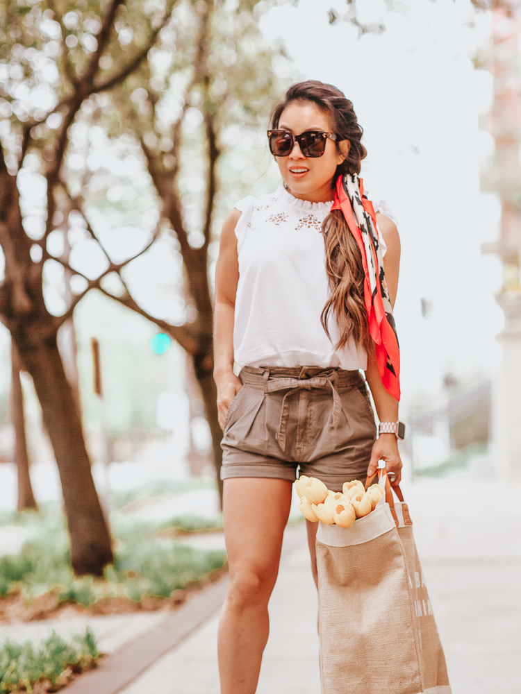 Easy Braid Tutorial featured by top US beauty blog Cute & Little; Image of a woman wearing LOFT Floral Lace Ruffle Shell, AE High Waist Paperbag Shorts, Steve Madden 'Blondy' wedges, Red Dress 'Pounce On It' Leopard Scarf, Amazon Santa Barbara Tote, Aerie 'Good Day' Sunglasses and Fitbit 'Versa' watch.