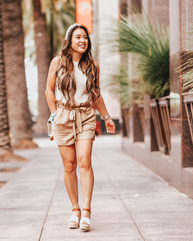 cute & little | popular dallas fashion blog | loft sweater tank, linen drawstring shorts, espadrille sandals, amazon pearl beaded headband | casual summer outfit | Sweater Tank: The Staple You Need This Summer by popular Dallas petite fashion blog, Cute and Little: image of a woman standing outside and wearing  a LOFT Shimmer Sweater Tank, Express High Waisted Sash Tie Linen-Blend Utility Shorts, J.Crew Platform espadrille sandals in two-tone leather, Pearl Headband for Women Girls Fashion Hair Accessaries Wide S.Cafe Mesh Fabric Cross Knot Pearl Hair Hoop for Wedding Party  by yaxunteng, and Neiman Marcus Gucci GG Marmont Chevron Quilted Leather Flap Wallet on a Chain.