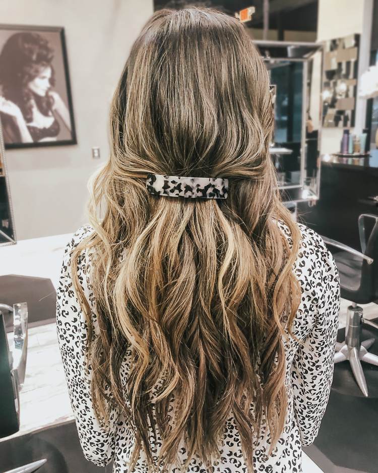 cute & little | popular dallas fashion blog | hand-tied hair extensions before/after faq | Everything You Need To Know About Tie In Hair Extensions by popular Dallas beauty blog, Cute and Little: image of the back of a woman's head with tie in hair extensions.