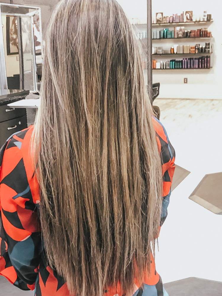 cute & little | popular dallas fashion blog | hand-tied hair extensions before/after faq | Everything You Need To Know About Tie In Hair Extensions by popular Dallas beauty blog, Cute and Little: image of a woman with tie in hair extensions.