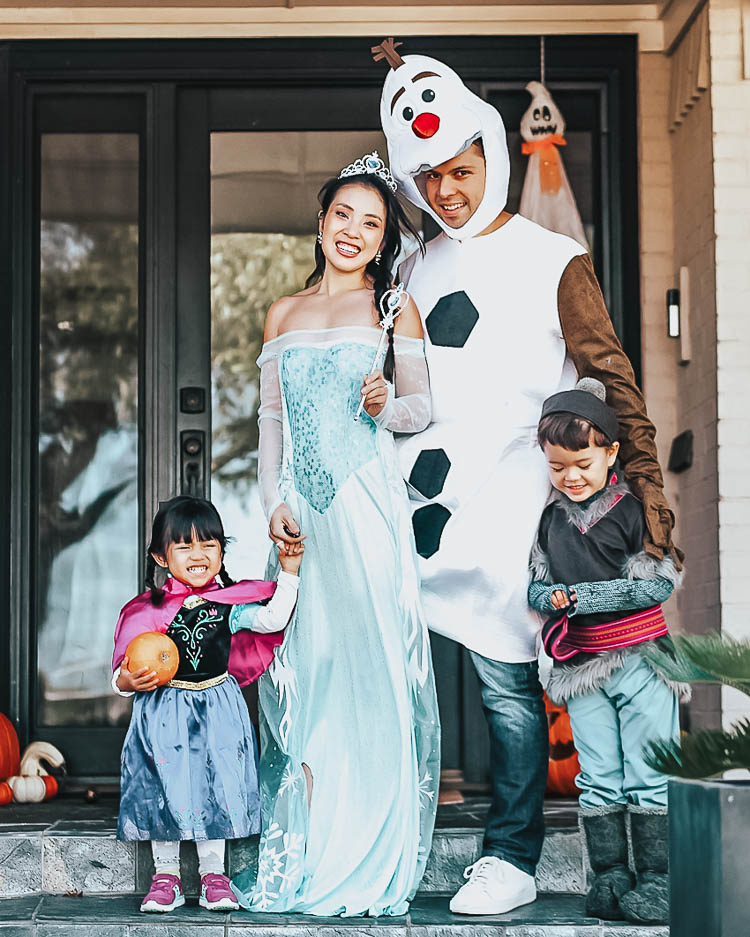 cute & little | dallas family fashion blog | family 4 group halloween costume idea | frozen olaf elsa anna kristoff | Last Minute Halloween Costumes for Families by popular Dallas petite life an style blog, Cute and Little: image of a family wearing Amazon Disguise Frozen costumes.
