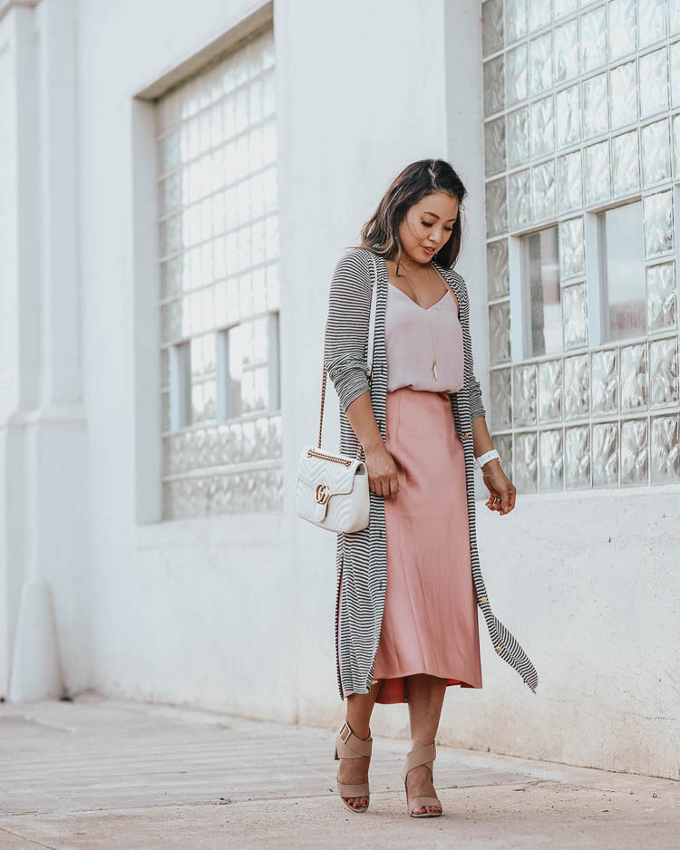 Silk slip skirt midi style for Fall by top US petite fashion blog, cute & little: image of a woman wearing a JCrew silk slip midi skirt, LOFT striped cardigan, Express Cami, Splendid Jayla shoes. | cute & little | dallas petite fashion blog | loft striped long duster cardigan, blush pink silk slip midi skirt | work office business casual outfit