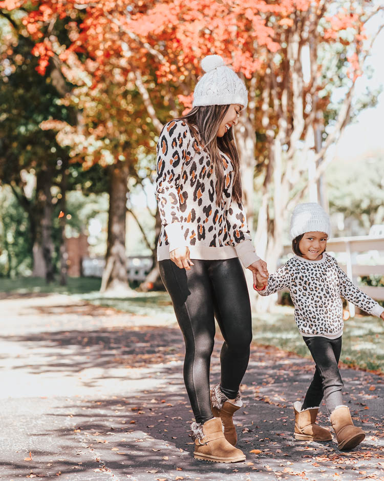 cute & little | popular dallas petite fashion blog | target leopard sweater, spanx black faux leather legging, toddler girl leopard sweater, bearpaw koko ugg boots, bearpaw rosie boots | fall winter matching mommy daughter outfit | Mommy and Me Matching Outfits: Leopard and Bearpaw Boots by Dallas petite fashion blog, Cute and Little: image of a mom and daughter outside playing in the leaves in wearing Target A New Day Women's Leopard Print Long Sleeve Rib-Knit Cuff Crewneck Pullover Sweater, Nordstrom Spanx Faux Leather Leggings, DSW KOKO BOOTIE, Aerie LEMON WINTER CABIN POM BEANIE, Nordstrom Tucker and Tate TUCKER + TATE Sparkle Leopard Spot Sweatshirt, Main, color, IVORY EGRET SNOW LEOPARD DETAILS & CARE This sweatshirt will be the one she chooses most often on school days, thanks to the combination of pink sparkles and leopard spots. 58% cotton, 37% polyester, 5% spandex Machine wash, tumble dry Imported Kids' Wear Item #5874206 Free Shipping & Returns See more Sparkle Leopard Spot Sweatshirt, Target Cat & Jack Toddler Girls' Leggings, and DSW kids KOKO BOOT.