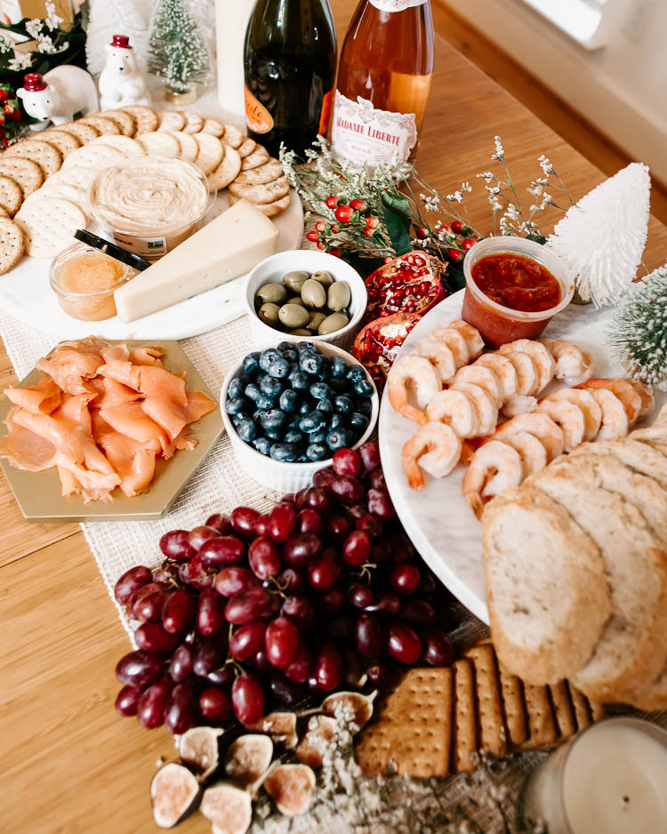 cute & little | dallas mom lifestyle blog | how to throw no-cook holiday new years party whole foods affordable | grazing table charcuterie board | How-To Throw Holiday Party with No Cook Appetizers by popular Dallas life and style blog, Cute and Little: image of Whole Foods Tsar Nicoulai, Whitefish Roe American Golden, Whole Foods 365 Everyday Value, Assorted Entertainment Crackers, Whole Foods Hummus Original, Whole Foods Kitchen's Seafood Shrimp Cocktail Tail-on Shrimp w/ Cocktail Sauce, Whole Foods Bread Loaf Seeduction, Whole Foods Santa Barbara Smokehouse, Smoked Atlantic Salmon, and Whole Foods Divina, Olives Casetelvetrano Organic.