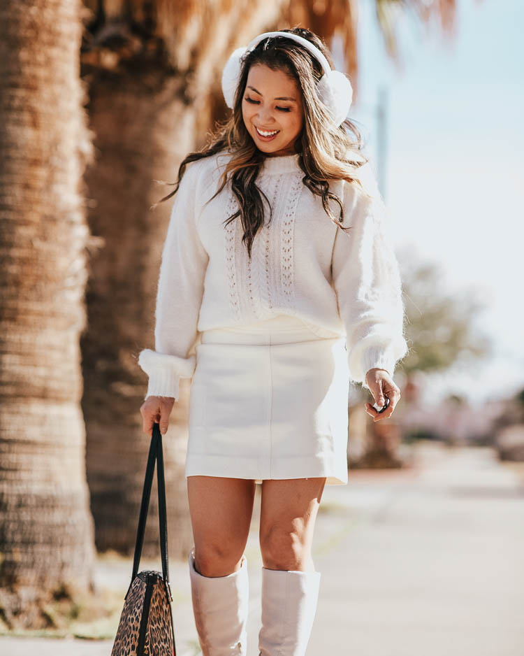cute & little | dallas petite fashion blog | j.crew point sur sweater, j.crew white mini skirt, justfab white all or nothing white boots, white earmuffs, chico's leopard tote bag | winter white outfit