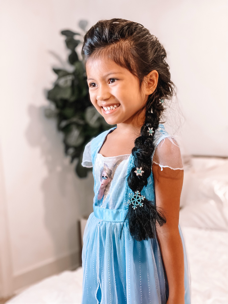 cute & little | disney frozen elsa french braid hair tutorial | tangle teezer hair brush review |Elsa Braid by popular Dallas beauty blog, Cute and Little: image of a girl with an Elsa braid accented with snowflake hair clips and wearing a Elsa dress.