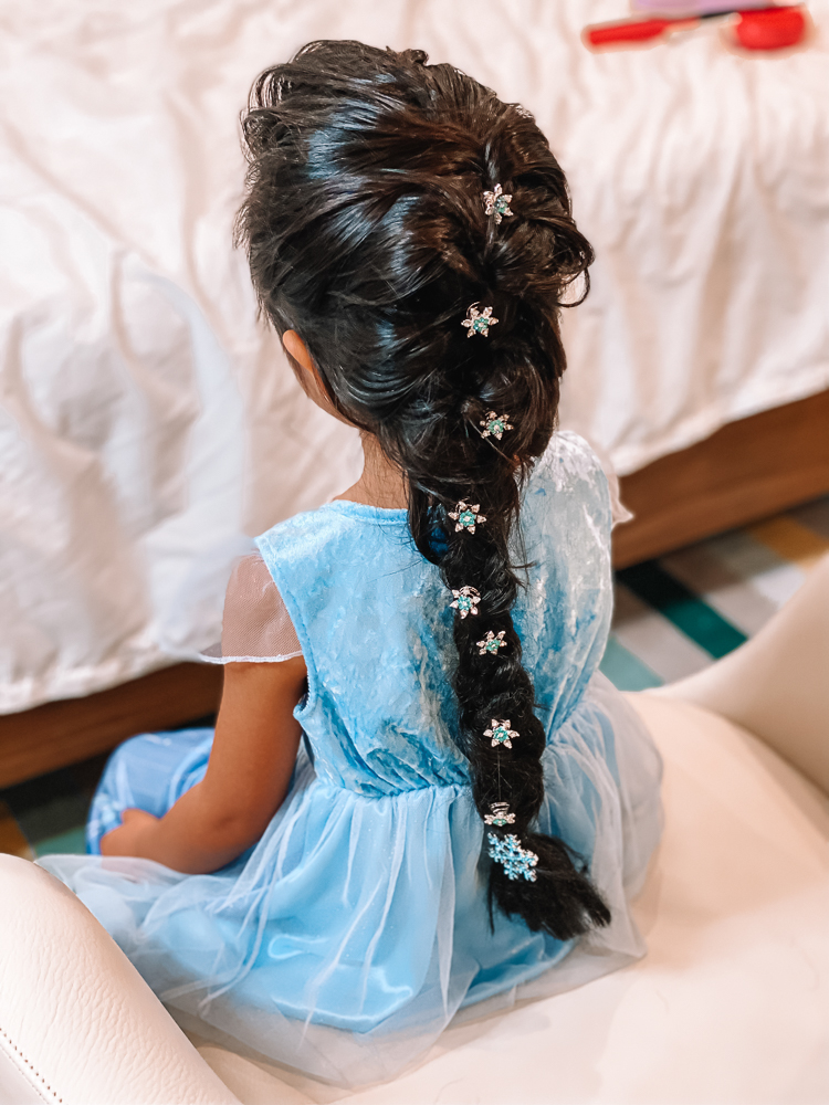 cute & little | disney frozen elsa french braid hair tutorial | tangle teezer hair brush review | Elsa Braid by popular Dallas beauty blog, Cute and Little: image of a girl with an Elsa braid accented with snowflake hair clips and wearing a Elsa dress.