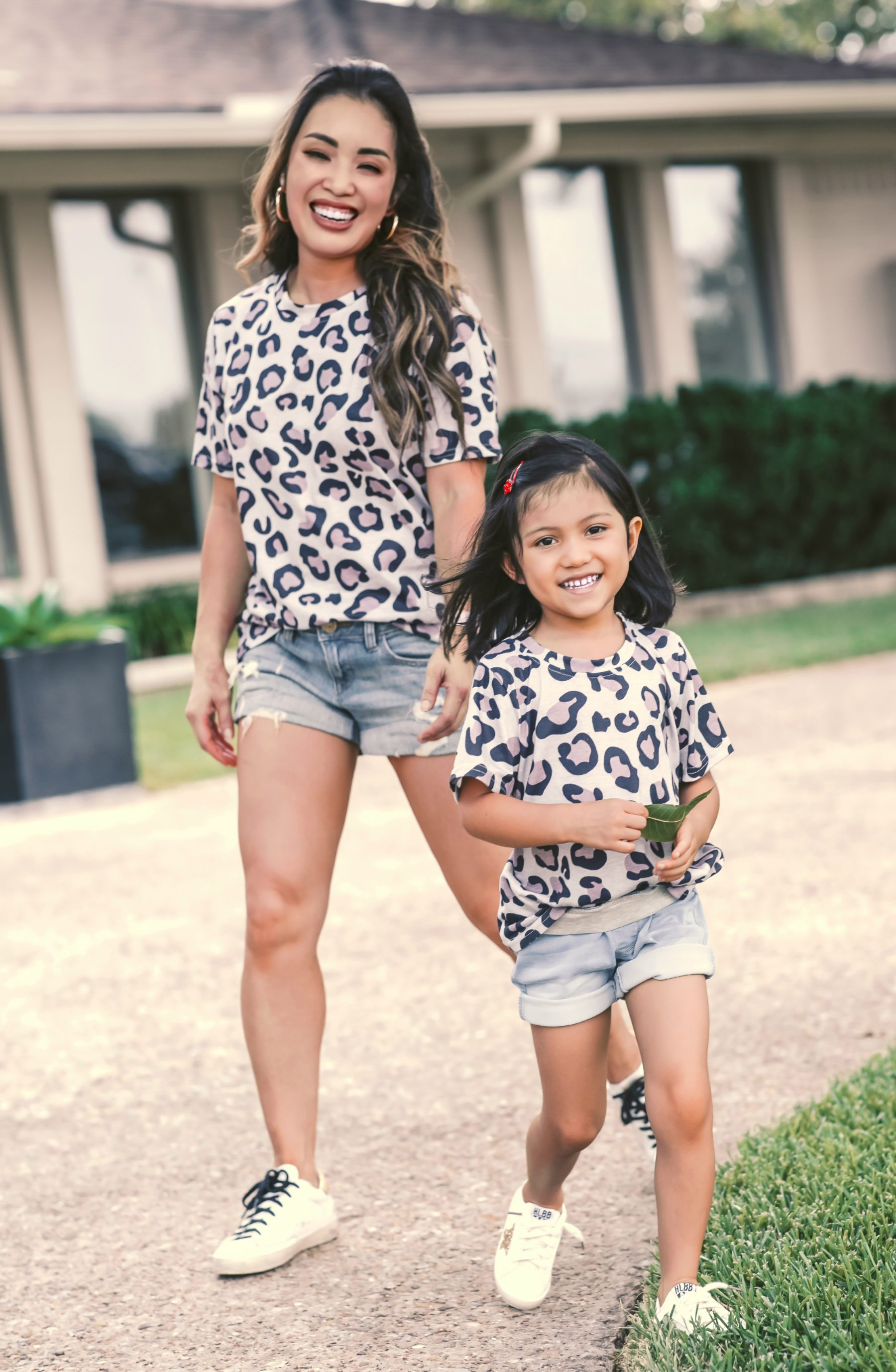 cute & little | dallas petite fashion mom blog | matching leopard shirt, jean shorts, golden goose superstar sneakers review dupes | mommy daughter matching outfits |Golden Goose Sneakers by popular Dallas petite fashion blog, Cute and Little: image of a mom and daughter wearing matching leopard print tops, Express denim shorts, GOLDEN GOOSE Superstar leather sneakers, and Amazon LanXi Girls Kids Spring Sparkle Star Bling Sequins Sneakers.
