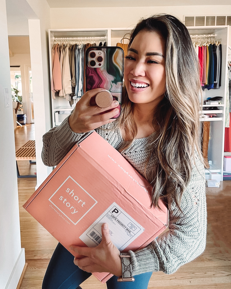 Short Story Box by popular Dallas petite fashion blog, Cute and Little: image of a woman holding a Short Story box.