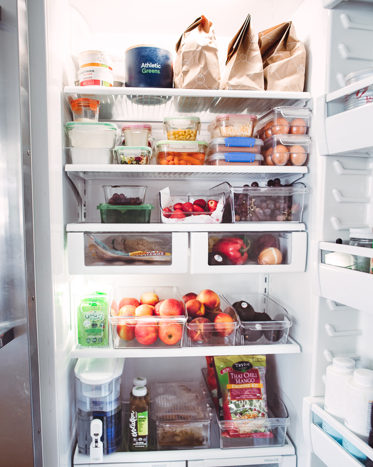 cute & little | dallas mom lifestyle blog | fridge organization tips and must-haves from walmart |Walmart Fridge Organization by popular Dallas lifestyle blog, Cute and Little: image of an open fridge.